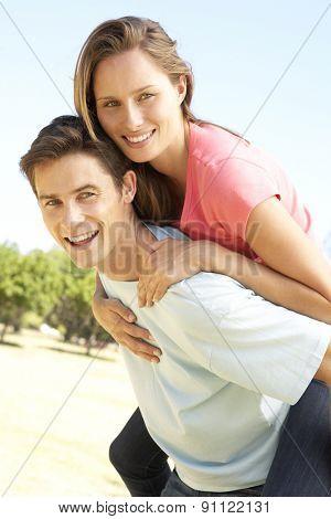 Young Couple Having Fun Piggyback Ride