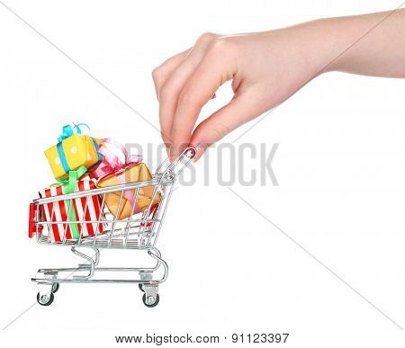 Female hand with small shopping cart full of gifts, isolated on white