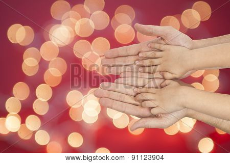 Father And Son Holding Hands On Christmas Lights Background