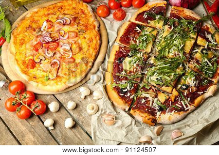 Tasty pizza with vegetables on table close up