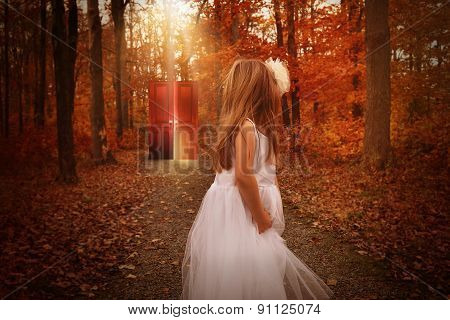 Child In Woods Looking At Glowing Red Door