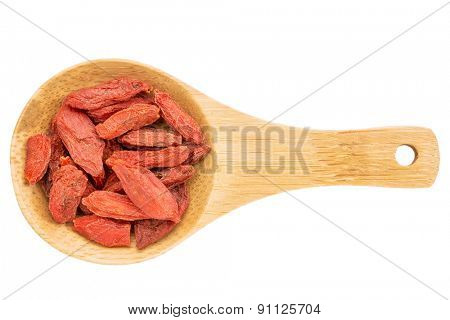 on a small wooden spoon isolated on white with a clipping path