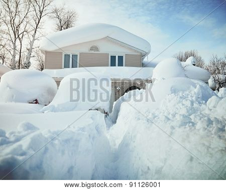 Snow Covered House From Blizzard