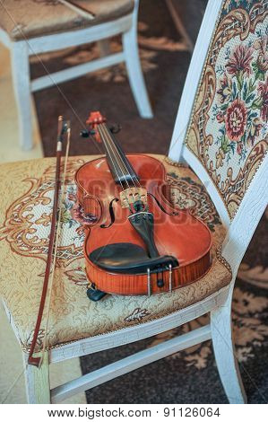 Classic music violin vintage close up. Violin on chair