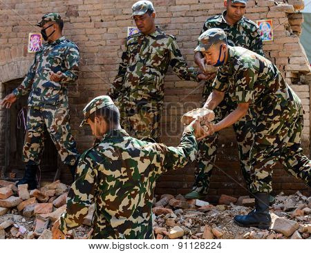 KATHMANDU, NEPAL - MAY 14, 2015: Military personnel during a  rescue operation after a 7.3 earthquake hit Nepal on May 12, 2015.