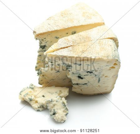 Pieces of tasty blue cheese isolated on white