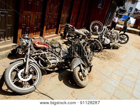 KATHMANDU, NEPAL - MAY 14, 2015: Crushed motorbikes are left in a street near Durbar Square after two major earthquakes hit Nepal in the past weeks.