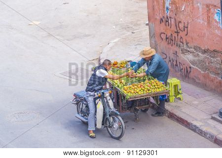 MARRAKESH, MOROCCO, APRIL 3, 2015: Vendor of  opuntia fruits offers his merchandise on street