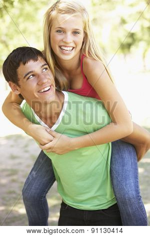 Teenage Couple Having Fun In Park Together