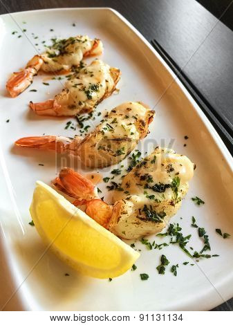 Grilled Shrimps On A White Plate