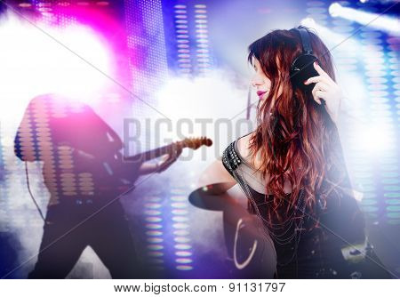 beautiful woman listening to music with headphones and singing. Live music background
