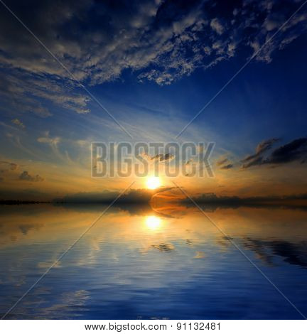 Abstract sunset over water surface