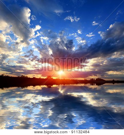 Sunset sky over water surface