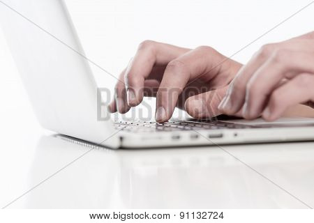 Closeup Of Fingers Using Keyboard