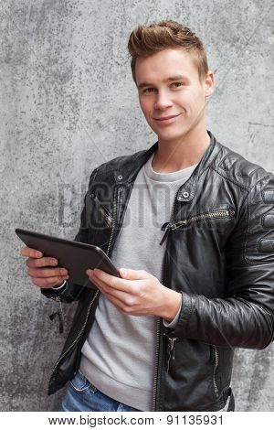 Casual young guy using tablet device