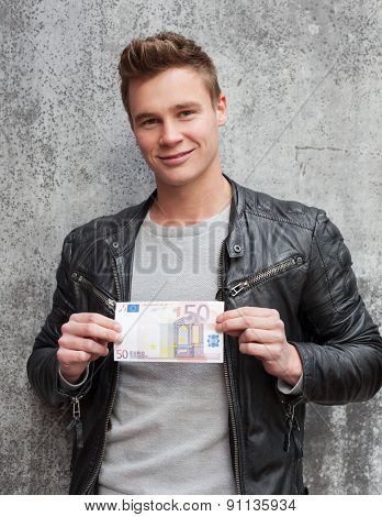 Casual young guy holding 50 euro note