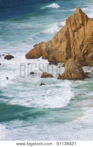 Wave and stone in Cabo da Roca, Areia, geographical point of western Europe, Portugal.