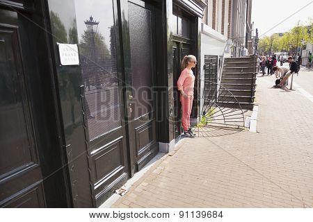 Tourist Girl Posing For Original Anne Frank House In Amsterdam