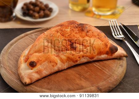 Calzone traditional italian dish and ingredients.