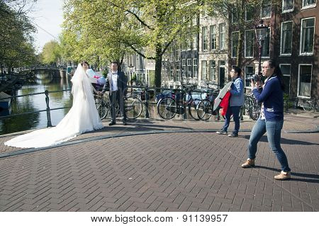Bride And Groom Pictures On Bridge Over Amsterdam Canal