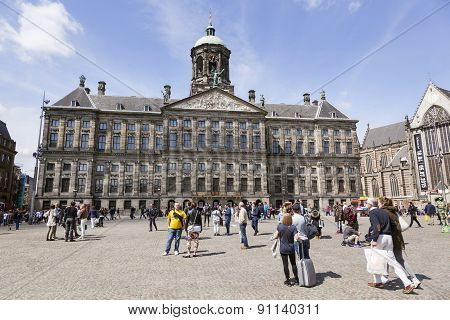 People On Dam Square In Front Of Amsterdam Royal Palace