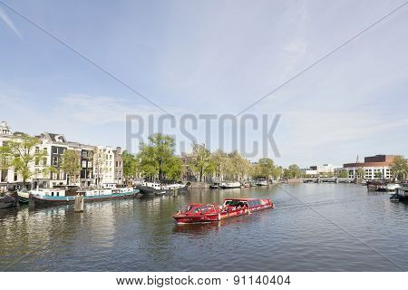 Canal Boat On River Amstel In Amsterdam