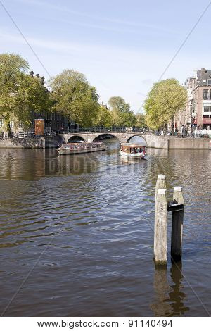 Boats On Amstel And Herengracht In Amsterdam