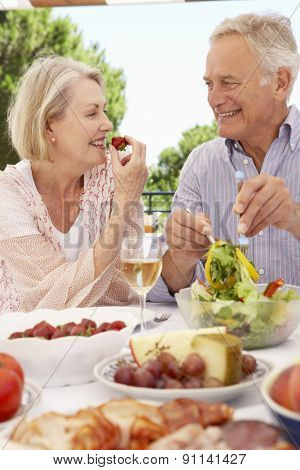 Senior Couple Enjoying Outdoor Meal Together