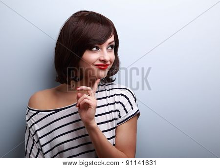Happy Thinking Young Woman Looking On Empty Copy Space