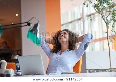 happy young curly  business woman in the modern office