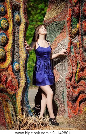 Beautiful Girl Smiling In A Blue Dress In The Summer Park