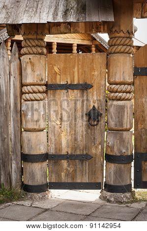 Old Wooden Door On Metal Hinges