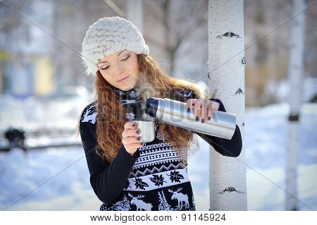 Beautiful Girl With Thermos And Cup Hot Tea In Frosty Winter Day