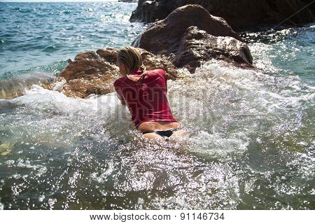 Sexy Girl In Sportwear And Tanga On The Rocky Beach
