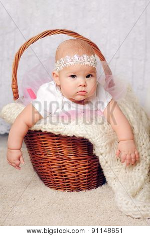 cute little girl in basket with lace headband