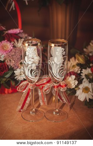 Two Glasses And Bouquet Of The Bride On A Stone Handrail
