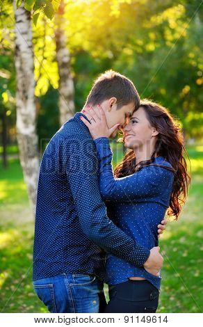 Close Up Portrait Of Young Happy Couple Outdoors