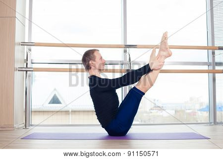 fitness, sport, training and lifestyle concept - man doing exercises on mat in gym, pilates