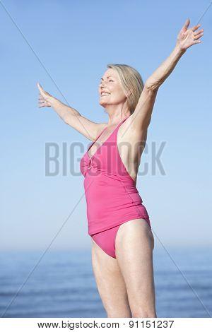 Senior Woman Standing On Summer Beach