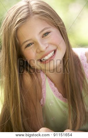 Portrait Of Young Girl Relaxing In Countryside