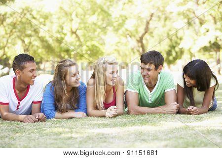 Group Of Teenage Friends Having Fun In Park