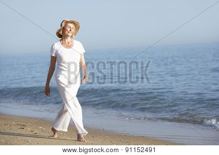 Senior Woman Enjoying Beach Holiday