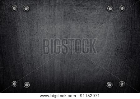 tack on black wood board