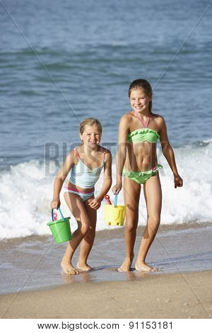 Two Young Girls Enjoying Beach Holiday