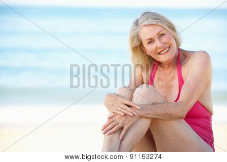 Senior Woman Sitting On Summer Beach