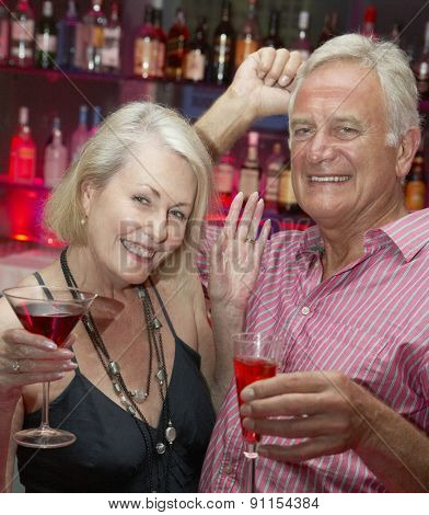 Senior Couple Enjoying Drink In Bar