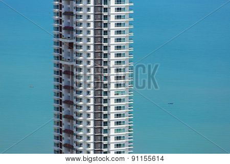 Skyscraper in Penang, Malaysia against blue sea