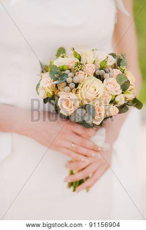 Beautiful Wedding Bouquet Of Flowers In Hands Of Bride