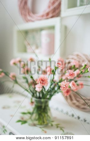 Beautiful Pink Flowers In A Vase On White Rustic Table