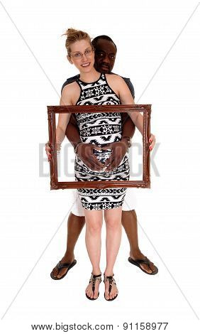 Pregnant Couple With Picture Frame.